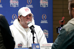 Creed Humphrey #56 of the Oklahoma Sooners of the Oklahoma Sooners speaks with the media at Media Day on Thursday, Dec. 26, in Atlanta. LSU will face Oklahoma in the 2019 College Football Playoff Semifinal at the Chick-fil-A Peach Bowl. (Paul Abell via Abell Images for the Chick-fil-A Peach Bowl)