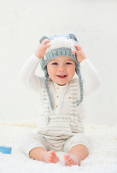 Baby Boy Wearing Knitted Hat Smiling