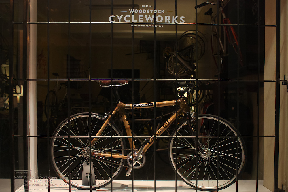 The storefront of Woodstock Cycleworks in Woodstock, Cape Town with a typical simple fixed gear in the window.