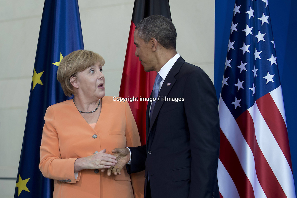 59860281   <br /> Barack Obama, president of the USA, and German Chancellor Angela Merkel (left) during a press call at a state visit of the Chancellery in Berlin, Germany. Barack Obama will walk in John F. Kennedy's footsteps this week on his first visit to Berlin as US president, but encounter a more powerful and sceptical Germany in talks on trade and secret surveillance practices. International Politics, Berlin, Germany on Wednesday 19 June, 2013. UK ONLY