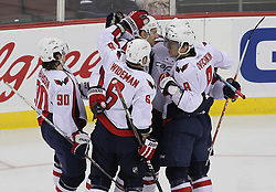 Mar 18; Newark, NJ, USA; Washington Capitals celebrate a goal by Washington Capitals defenseman Jeff Schultz (55) during the first period at the Prudential Center.
