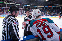KELOWNA, CANADA - MARCH 14: Linesmen Cody Wanner and Dustin Minty stand on the ice and speak to Dillon Dube #19 of the Kelowna Rockets on the bench against the Prince George Cougars on March 14, 2018 at Prospera Place in Kelowna, British Columbia, Canada.  (Photo by Marissa Baecker/Shoot the Breeze)  *** Local Caption ***