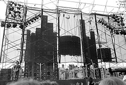 "Grateful Dead with the Wall of Sound in Concert at Dillon Stadium in Hartford CT on the 31st of July 1974. Keith is off to the right out of frame. During the First Set. The hot sun is setting to the left just out of frame. This photo is shot about 75' from the stage showing the entire east coast road tour version of The Wall. Limited Edition Prints only available of this image. No stock sale or publication use of this image available. Only Prints and 16x24"" is recommended for true impact."