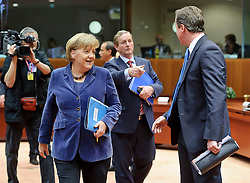 "Angela Merkel, Germany's chancellor, left, speaks with Enda Kenny, Ireland's prime minister, center, and David Cameron, the U.K.'s prime minister, right, during an emergency EU Summit to solve Europe's debt crisis at the European Council headquarters in Brussels, Belgium, on Wednesday, Oct. 26, 2011. ""The world is watching Europe and Germany,"" Germany's Chancellor Angela Merkel said in a speech today to the lower house in Berlin, the Bundestag. (Photo © Jock Fistick)"