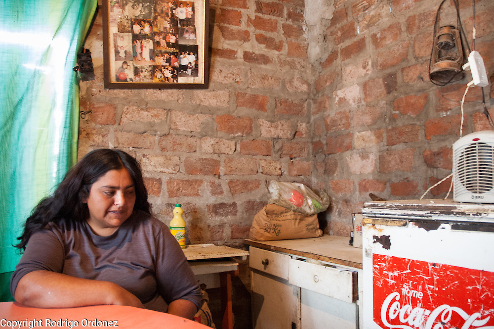 M&oacute;nica &lsquo;Cori&rsquo; Jim&eacute;nez is a single mother with five children. &quot;I grew up alone, in the streets,&quot; she said. &quot;I never stole anything and I never took drugs.&quot; She survives on government assistance and the community soup kitchen. &quot;If it didn&rsquo;t exist, I don&rsquo;t know what would have happened to my life and to the lives of my children.&quot; <br /> She used to be a 'cartonera' in downtown Buenos Aires for 15 years. She used to take her children out to beg until, in an argument, her older daughter convinced her that it was wrong. Cori combed trash at the municipal trash dump for three months, but she says she stopped because police beat her often and once shot her in the leg with a rubber bullet. After a childhood of mistreatment, Cori hopes life in 8 de Mayo will offer something better to her kids. <br /> &quot;I am 30 and I already want to die,&quot; she told a visitor, slowly and deliberately, with her eyes fixed on the ground. &quot;I want my children to be someone in life.&quot;