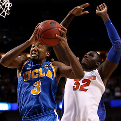 Mar 19, 2011; Tampa, FL, USA; UCLA Bruins guard Malcolm Lee (3) shoots over Florida Gators center Vernon Macklin (32) during second half of the third round of the 2011 NCAA men's basketball tournament at the St. Pete Times Forum. Florida defeated UCLA 73-65.  Mandatory Credit: Derick E. Hingle