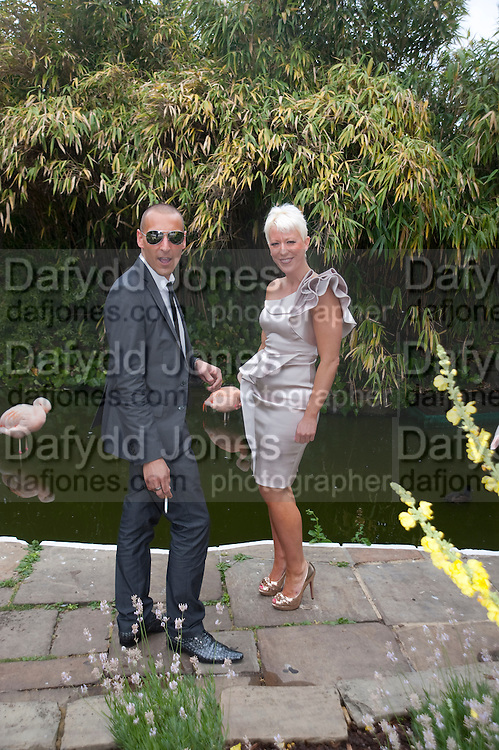 SEAN-PAUL ROBERTS; HEATHER JONES-HUGHES, Archant Summer party. Kensington Roof Gardens. London. 7 July 2010. -DO NOT ARCHIVE-© Copyright Photograph by Dafydd Jones. 248 Clapham Rd. London SW9 0PZ. Tel 0207 820 0771. www.dafjones.com.