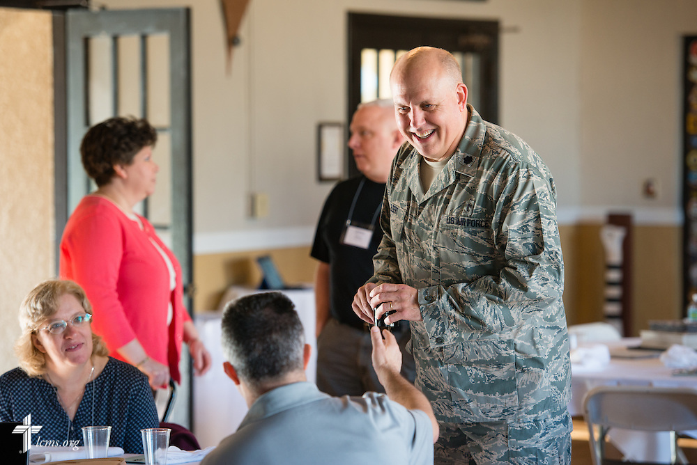 Chaplain Thomas Elbert (standing) chats with Chaplain Michael Moreno during break at the 2015 West Coast Lutheran Chaplains Professional Development Seminar Tuesday, Jan. 27, 2015, at North Island Naval Air Station in San Diego, Calif. LCMS Communications/Erik M. Lunsford