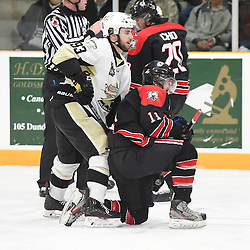 TRENTON, ON - Apr 22, 2016 -  Ontario Junior Hockey League game action between the against the Trenton Golden Hawks and the Georgetown Raiders. Game 5 of the Buckland Cup Championship Series, at the Duncan Memorial Gardens in Trenton, Ontario. Curtis Harvey #93 of the Trenton Golden Hawks battles for control with Bailey Molella #11 of the Georgetown Raiders during the second period.<br /> (Photo by Andy Corneau / OJHL Images)