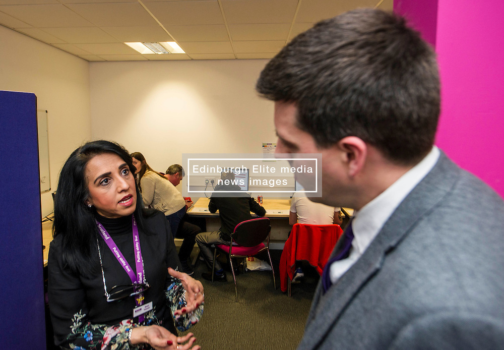 Pictured: Butal Hassan outlines her path to Remploy to Mr Hepburn<br /> <br /> Today, Minister for employability and training, Jamie Hepburn MSP visited Remploy in Edinburgh where he announced new employment services funding. Mr Hepburn gave details on cash which will develop new ways of supporting the Scottish Government's new devolved employment services. <br /> <br /> Ger Harley | EEm 21 December 2016