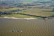 Nederland, Gelderland, Millingerwaard, 11-02-2008; binnevaartschip op de Waal, de Millingerwaard in het verschiet; dit natuurontwikkelingsgebied in het hart van de Gelderse Poort; is ontstaan door het winnen van klei (kleiputten); tijdens hoog water verandert de Millingerwaard in een kilometersbrede overstromingsvlakte...luchtfoto (toeslag); aerial photo (additional fee required); .foto Siebe Swart / photo Siebe Swart