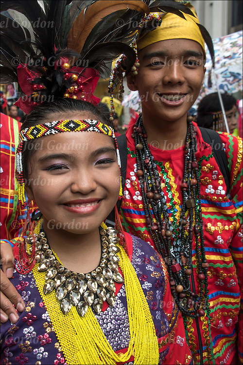 Ethnic Pride for second generation Filipinos in the Philippine Day Day Parade. They are wearing Carnival regalia and headdress.
