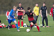 FC Kettledrum (red and black) v Monifieth Hurricanes (blue and white) in the Dundee Saturday Morning Football League at Drumgeith, Dundee, <br /> <br />  - © David Young - www.davidyoungphoto.co.uk - email: davidyoungphoto@gmail.com