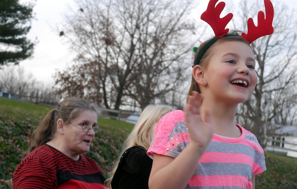 Alissa Ponton, 7 of Nelson County shows her excitement while watching the Stuarts Draft Christmas Parade Saturday, Dec. 12, 2015.