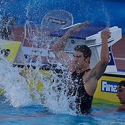 Michael Phelps, USA, celebrates winning the men's 100m Butterfly at the World Swimming Championships in Rome on Saturday, August 01, 2009. Photo Tim Clayton.