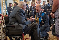 The Duke of Cambridge speaks to Jock Heatherill, 95, wing commander of 158th squadron, Halifax's, during a reception at Buckingham Palace, London to mark the centenary of the Royal Air Force.