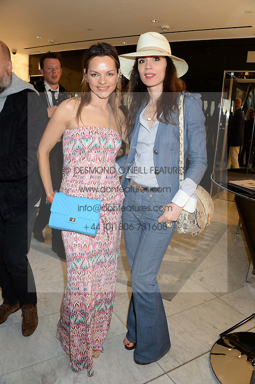 Left to right, MARIA HATZISTEFANIS and LARA BOHINC at the launch of the Odabash Macdonald Resort 2014 swimwear collection at ME Hotel, London on 25th June 2013.