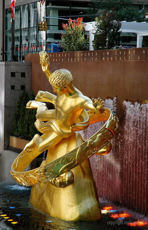 Rockefeller gold statue, vertical