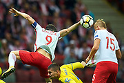 Warsaw, Poland - 2017 September 04: (R) Kamil Glik from Poland shoots on the goal during soccer match Poland v Kazakhstan - FIFA 2018 World Cup Qualifier at PGE National Stadium on September 04, 2017 in Warsaw, Poland.<br /> <br /> Adam Nurkiewicz declares that he has no rights to the image of people at the photographs of his authorship.<br /> <br /> Picture also available in RAW (NEF) or TIFF format on special request.<br /> <br /> Any editorial, commercial or promotional use requires written permission from the author of image.<br /> <br /> Mandatory credit:<br /> Photo by &copy; Adam Nurkiewicz / Mediasport