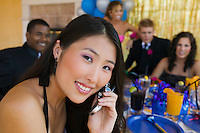 Teenage Girl at Party Using Cell Phone