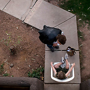 CPS after-hours investigator Wendy Rosenberg talks to a 4-year-old outside his apartment. The boy's mother had been taken to a psychiatric hospital after threatening suicide.<br /> A rare glimpse on Child Protective Services caseworkers working with kids who are abused or neglect by their families. A year ago, Arizona&rsquo;s broken child-welfare system and the children it&rsquo;s supposed to protect were the focus of intense debate, with politicians and experts searching for solutions to intractable problems. Several children had been killed under the watch of the state&rsquo;s Child Protective Services, a flood of foster children were swamping caseworkers and the Maricopa County attorney was accusing the agency of letting children fall through the cracks to their deaths. Caseworkers are scrutinize a lot because of lack of funding and tremendous workload.