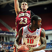 Denver's guard, Brett Olson (23), jumps to block South Alabama's guard Wendell Wright (10) in the first half of play in Mobile, AL. Denver leads South Alabama 30-24 at halftime on January 7, 2012...