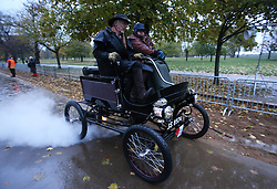 Dawn in Hyde Park, London as a competitor sets off at the start of the London to Brighton Veteran Car Run Sunday  4th November 2012.   Photo by: Stephen Lock / i-Images