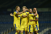AFC Wimbledon Players Celebrate after Portsmouth Defender, Anton Walkes (2) scores an own goal to make it 1-2 AFC Wimbledon Forward, Joe Piggott (39) during the Carabao Cup match between Portsmouth and AFC Wimbledon at Fratton Park, Portsmouth, England on 14 August 2018.
