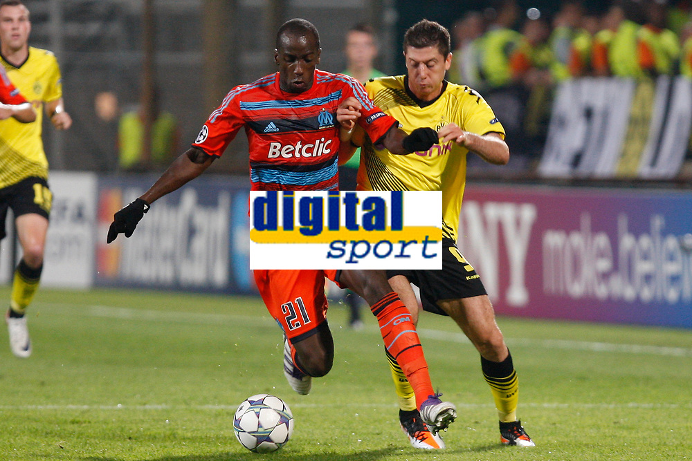 FOOTBALL - UEFA CHAMPIONS LEAGUE 2011/2012 - GROUP STAGE - GROUP F - OLYMPIQUE MARSEILLE v BORUSSIA DORTMUND - 28/09/2011 - PHOTO PHILIPPE LAURENSON / DPPI - Souleymane Diawara / Robert Lewandowski