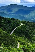 A winding mountain road as seen from the Roan Balds from Carvers Gap at Roan Mountain State Park in Tennessee.<br /> <br /> &copy; Photography by Kathy Kmonicek