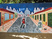 A tango mural shows a dancing couple, bandoneón player, cobblestone street, and city skyline in San Telmo barrio of Buenos Aires, Argentina, South America. Popular in Argentina and Uruguay, the bandoneón is a type of concertina which is essential in most tango ensembles from the traditional orquesta típicas of the 1930s and 1940s onwards. The bandoneón was named by German instrument dealer Heinrich Band (1821-1860). German sailors and Italian seasonal workers and emigrants brought the instrument with them to Argentina in the late 1800s, where it was incorporated into local milonga and tango music.