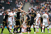 Nottingham Forest defender Danny Fox is shown a straight red card  during the Sky Bet Championship match between Milton Keynes Dons and Nottingham Forest at stadium:mk, Milton Keynes, England on 7 May 2016. Photo by Dennis Goodwin.