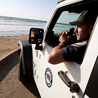 "Ed Vodrazka, 50, feels he'll be hearing a call come in over the radio any day now announcing a capsized boat with over twenty undocumented migrants in the heavy surf off of Torrey Pines State Beach. As a lieutenant lifeguard at Torrey Pines State Beach , Vodrazka would be the first to respond. He has seen four boats wash ashore and keeps a vigilant watch for others. For more images, search for ""immigration by air and sea"". Please contact Todd Bigelow directly with your licensing requests."