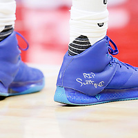 24 February 2016: Los Angeles Clippers guard Jamal Crawford (11) pays homage to Los Angeles Clippers fan Scott Bui during the Denver Nuggets 87-81 victory over the Los Angeles Clippers, at the Staples Center, Los Angeles, California, USA.