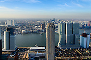 Nederland, Zuid-Holland, Rotterdam, 18-02-2015; skyline en binnenstad van Rotterdam, gezien vanaf de Kop van Zuid en de Wilhelminapier. Op de Wilhelminakade vlnr het World Port Center (Havenbedrijf Rotterdam), New Orleans en De Rotterdam. Laagbouw van Las Palmas.<br /> Newly developed cultural center Kop van Zuid, urban renewal and modern architecture, high rise in a former harbour area<br /> luchtfoto (toeslag op standard tarieven);<br /> aerial photo (additional fee required);<br /> copyright foto/photo Siebe Swart