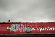 a young boy draws a grafity on wall, where can be read ''Eraldia' (Ocassion or opportunity in Basque language).  Donostia (Basque Country). May 1, 2015.  A group of people occupies the former factory of Firestone, which was abandoned long ago, to promote alternative models of work, relationship and lifestyle initiatives. They will call it 'Eraldia' (Ocassion or opportunity in Basque language) (Gari Garaialde / BostokPhoto)