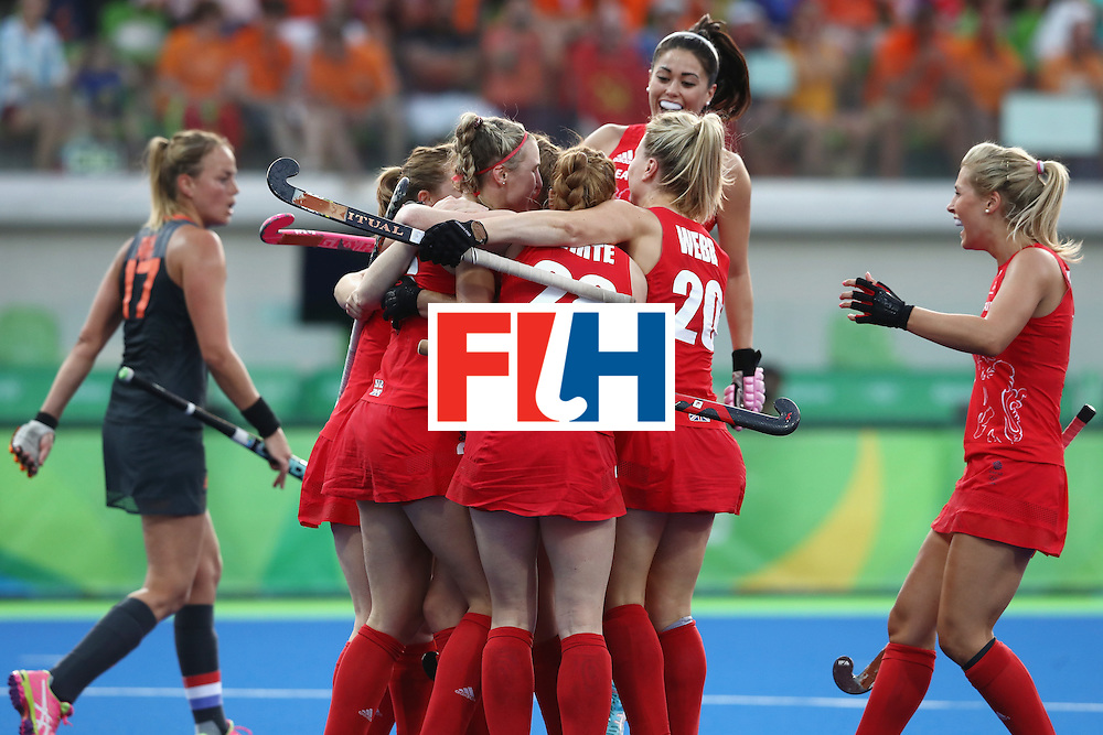 RIO DE JANEIRO, BRAZIL - AUGUST 19:  Great Britain players celebrate the opening goal scored by Lily Owsley during the Women's Gold Medal Match against the Netherlands on Day 14 of the Rio 2016 Olympic Games at the Olympic Hockey Centre on August 19, 2016 in Rio de Janeiro, Brazil.  (Photo by David Rogers/Getty Images)
