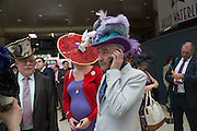 ANDREW FISH OF FISHHEAD HATS, Royal Ascot racegoers at Waterloo station. London. 19 June 2013.