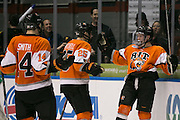 RIT players celebrate a second period goal against Robert Morris University during the Atlantic Hockey final at the Blue Cross Arena in Rochester on Saturday, March 19, 2016.