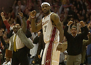 PHOTO BY DAVID RICHARD.LeBron James pumps his fist after teammate Flip Murray hit a 3-pointer to send the game into overtime.