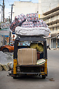 PUTTARPATHI, INDIA - 27th October 2019 - Rickshaw transporting goods through Puttarpathi town centre, Andhra Pradesh, South India.