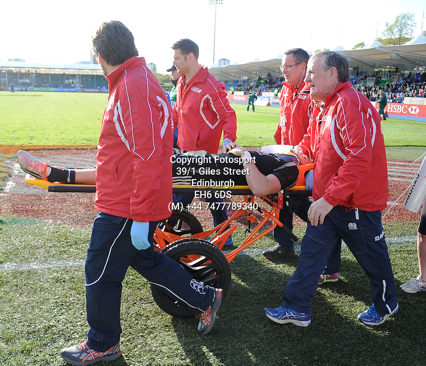 Tim Mikkelson - New Zealand is stretchered off injured by the medics after injuring himself whilst scoring a try in the corner.<br />