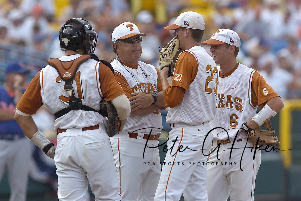 Texas pitching coach Tom Holliday (C) talks with pitcher Kyle McCulloch (23), as Longhorns Robby Hudson (6) and Taylor Teagarden (31) stand by.  Texas defeated Florida 6-2 for the National Championship at the College World Series at Rosenblatt Stadium in Omaha, Nebraska on June 26, 2005.