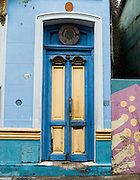 "Blue and yellow painted wood double doors in San Telmo barrio, the heart of old Buenos Aires, Argentina, South America. Admire well-preserved old buildings in San Telmo (""Saint Pedro González Telmo""), the oldest barrio (neighborhood) of Buenos Aires, in Argentina, South America."