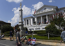 August 21, 2017 - Laurens, South Carolina, USA - Visitors prepare to watch the solar eclipse overlooking the American flag and the confederate monument in downtown Laurens, S.C.  on Monday, August 21, 2017. (Credit Image: © Fabian Radulescu via ZUMA Wire)