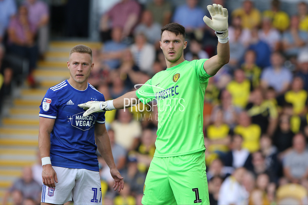Burton Albion goalkeeper Kieran O'Hara and Ipswich Town midfielder Danny Rowe during the EFL Sky Bet League 1 match between Burton Albion and Ipswich Town at the Pirelli Stadium, Burton upon Trent, England on 3 August 2019.