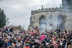 "© Licensed to London News Pictures. 06/01/2016. Haxey UK. Picture shows Dale Smith ""the fool"" addressing the crowd at The Haxey Hood that takes place today, The historic event dating back to the 14th century sees teams representing four pubs in Haxey & Westwoodside compete for a leather cylinder known as the hood. After a pub crawl around the participating pubs, the game begins with a famous speech from the ceremonial fool. The game is won when the scrum reaches one of the pubs and the hood is touched by the landlord or landlady. Photo credit: Andrew McCaren/LNP"