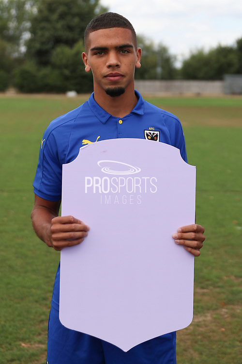 AFC Wimbledon defender Tennai Watson (2) holding Fifa sign during the AFC Wimbledon 2018/19 official photocall at the Kings Sports Ground, New Malden, United Kingdom on 31 July 2018. Picture by Matthew Redman.
