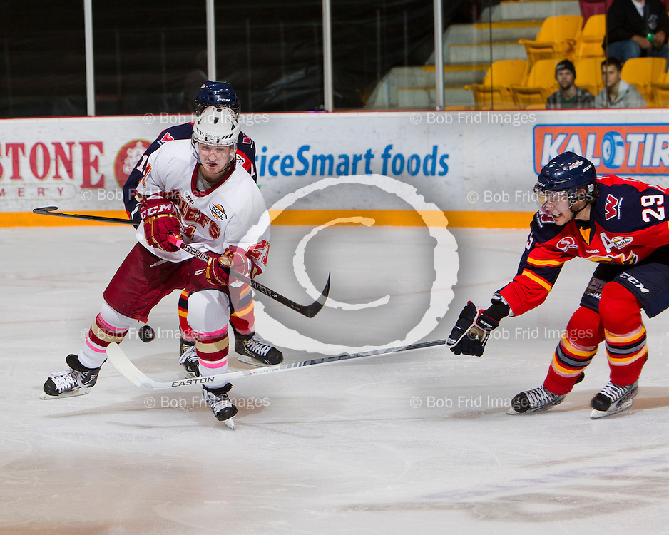 13 October 2012:  Tanner Cochrane (21) of the Chiefs and Ryan Renz (29) of the Vipers  during a game between the Chilliwack Chiefs and the Vernon Vipers at  Prospera Centre, Chilliwack, BC.    Final Score: Chilliwack 4  Vernon 1   ****(Photo by Bob Frid - All Rights Reserved 2012): mobile: 778-834-2455 : email: bob.frid@shaw.ca ****