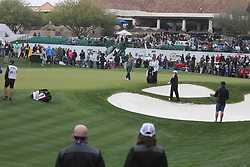 February 3, 2019 - Scottsdale, AZ, U.S. - SCOTTSDALE, AZ - FEBRUARY 03: Tom Hoge hits from between the sand traps on the 18th hole at the final round of the Waste Management Phoenix Open on February 3, 2019, at TPC Scottsdale in Scottsdale, Arizona.  (Photo by Will Powers/Icon Sportswire) (Credit Image: © Will Powers/Icon SMI via ZUMA Press)